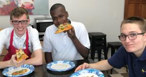 Kids enjoying pizza they made