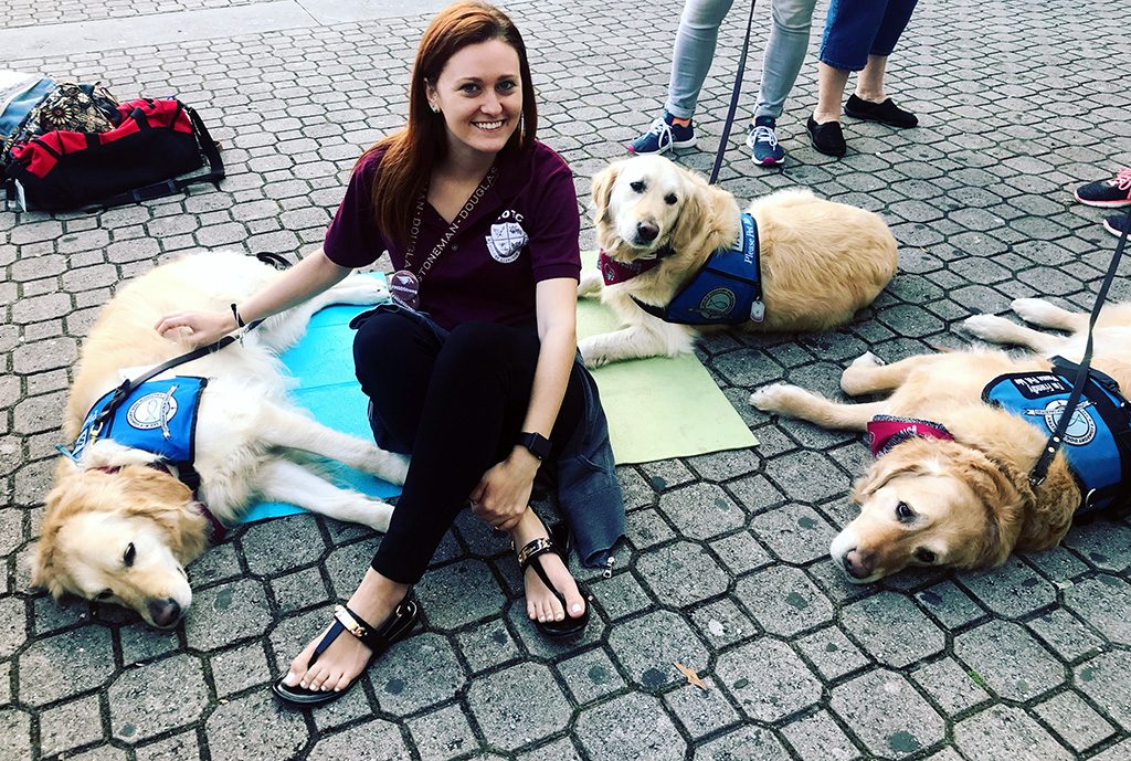 woman and therapy dogs